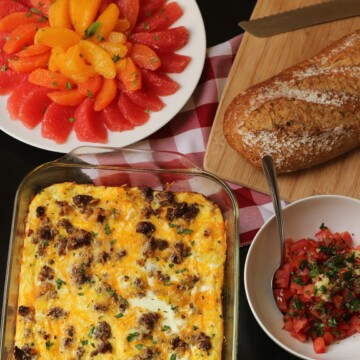 A baking dish of egg casserole next to breakfast dishes