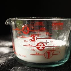 measuring cup with two cups of powdered sugar