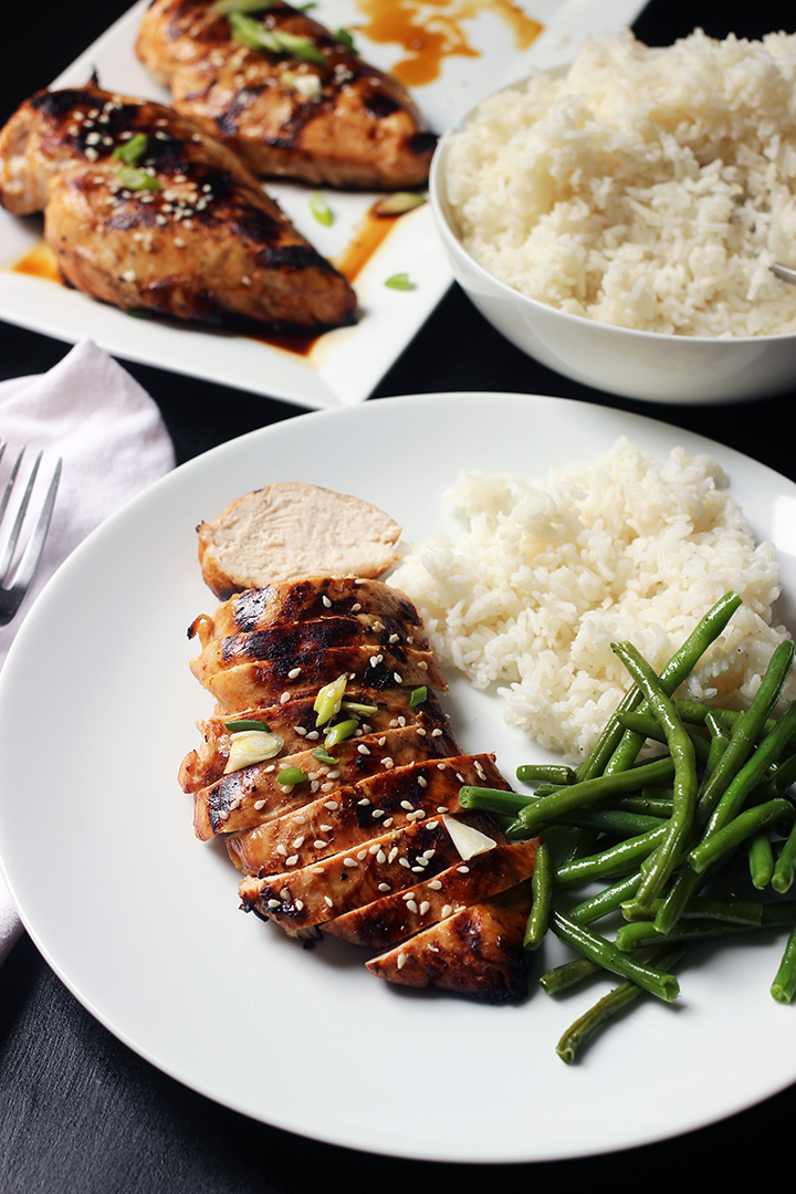 dinner plate of chicken on table set with chicken and rice