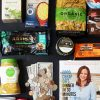 flatlay of groceries cookbook and money with coins and bills