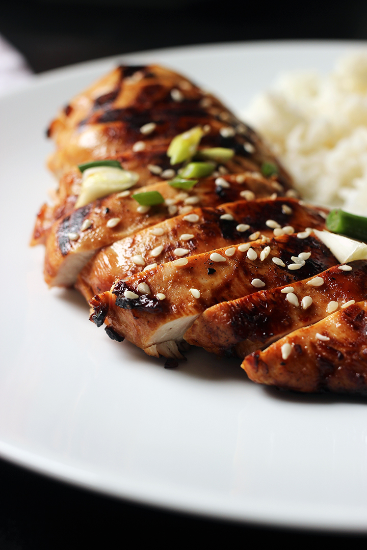 sliced Asian chicken breast on white plate