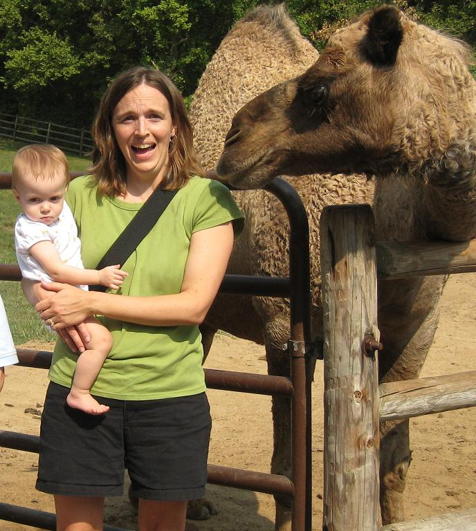 jessica holding baby with a camel in her face