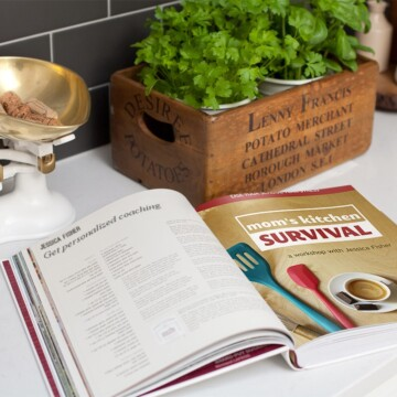 A book open with image of Mom's Kitchen Survival workshop