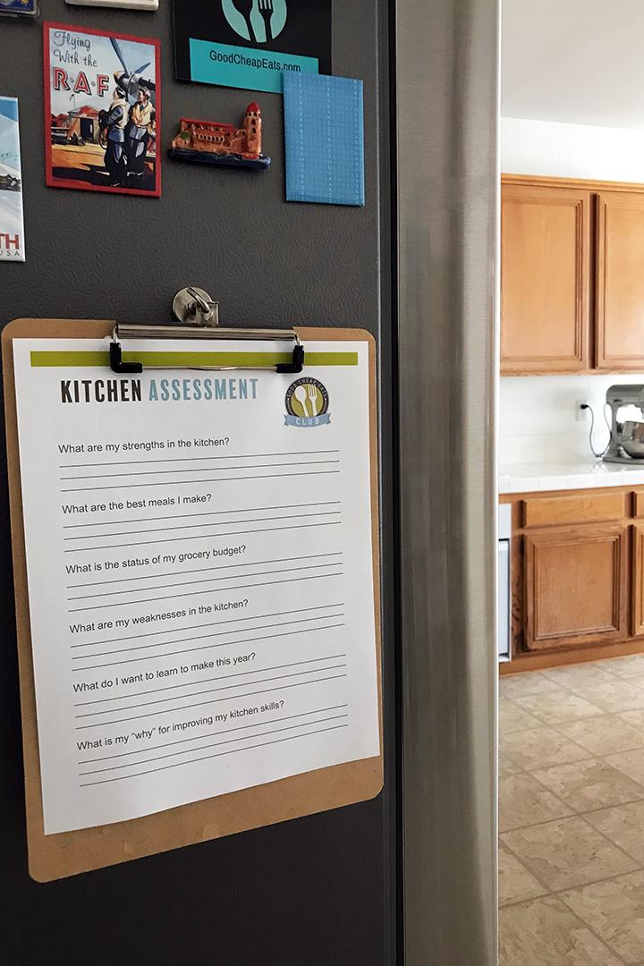 kitchen assessment worksheet on clipboard on side of fridge