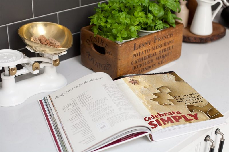 celebrate simply book open on kitchen counter