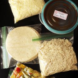 bags of ingredients for slow cooker enchilada kit