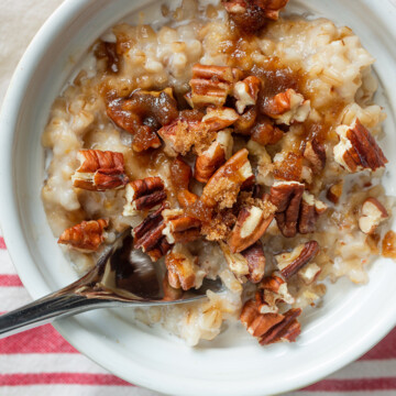 bowl of oats with spoon and red striped napkin