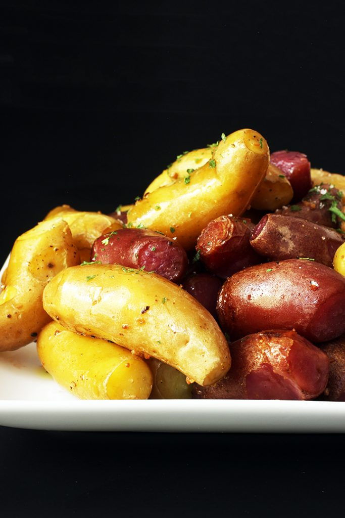 cooked garlic potatoes on white plate