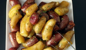 garlic potatoes on square white plate on black table