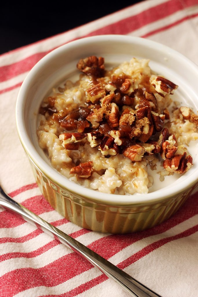 green ramekin with steel cut oats, pecans, and brown sugar