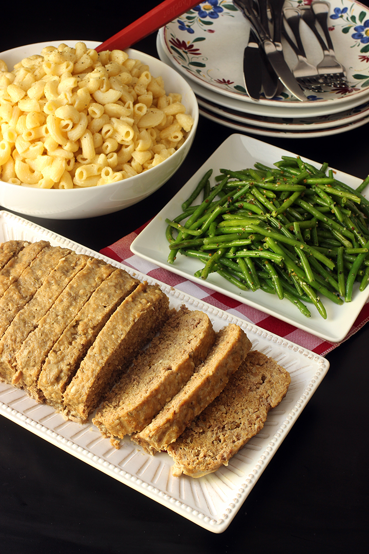meatloaf platter next to macaroni and green beans