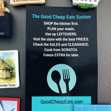 printed card of GCE system on refrigerator with magnets