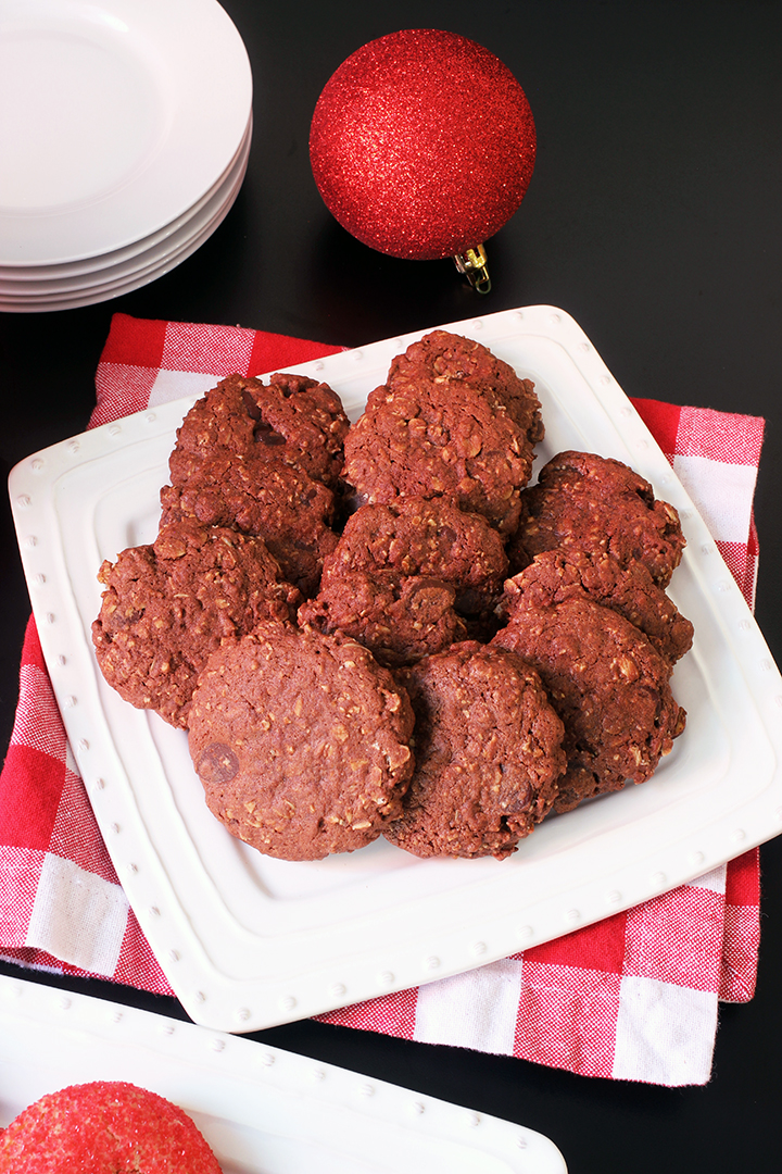 white tray of chocolate oatmeal cookies on red checked napkin