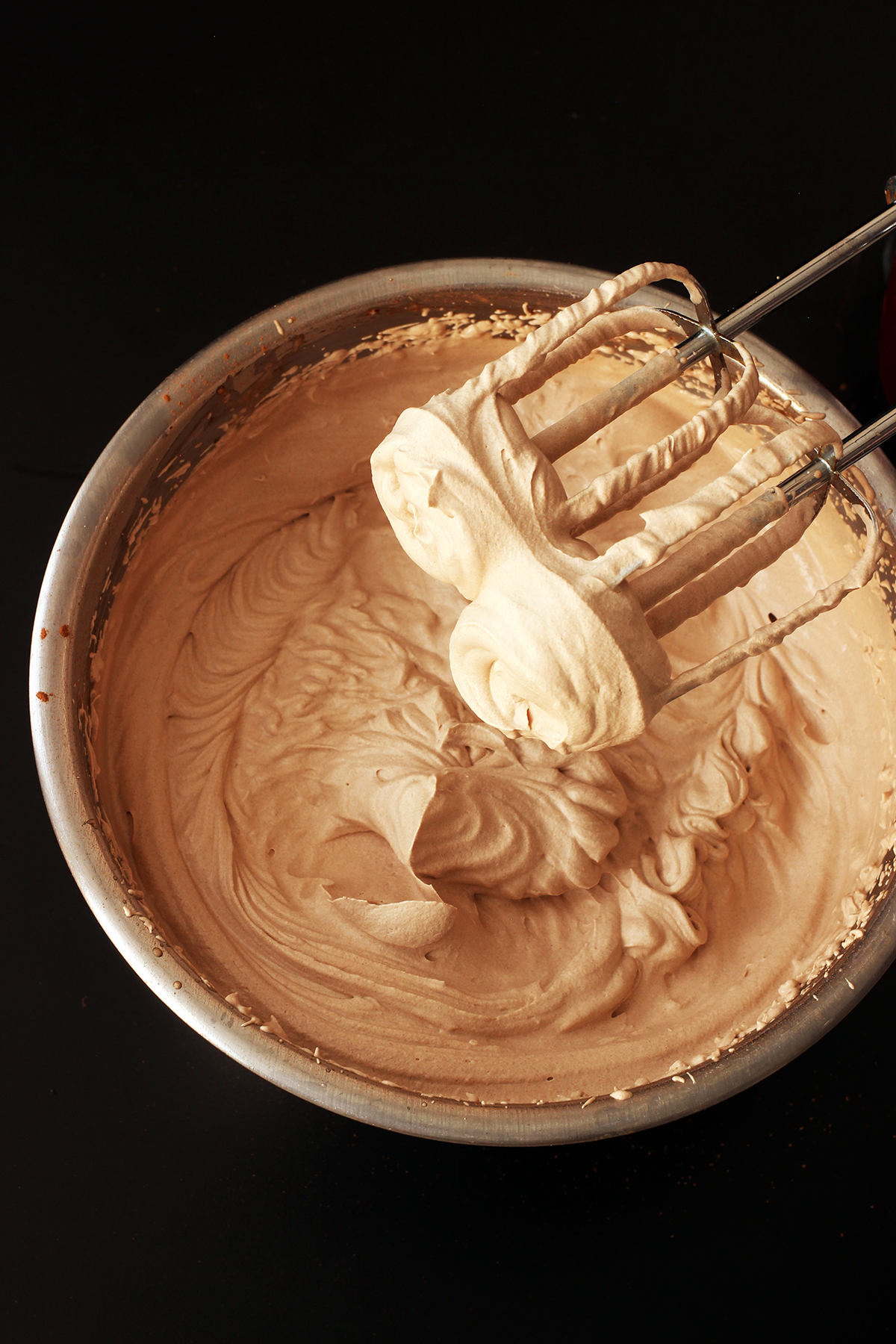 mixing bowl of chocolate whipped cream and beaters