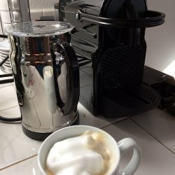 nespresso machine with capuccino and frother