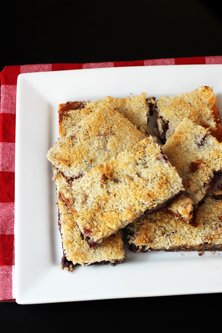 platter of cherry jam magic bars on red checked cloth