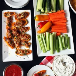 sausage peppers and sauce on appetizer table