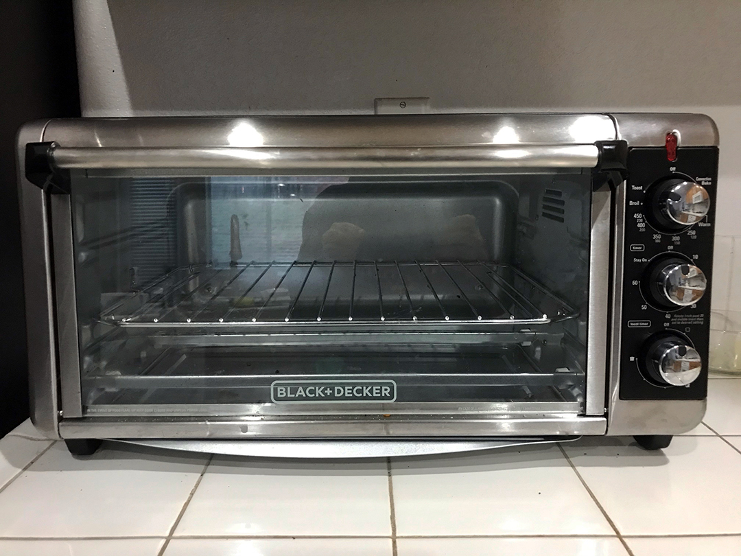 silver toaster oven on white countertop