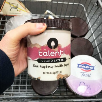 woman holding carton of talent in store
