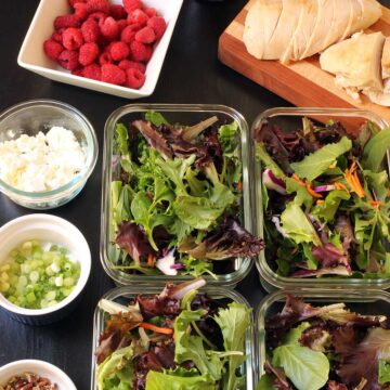 assembling raspberry salads in boxes