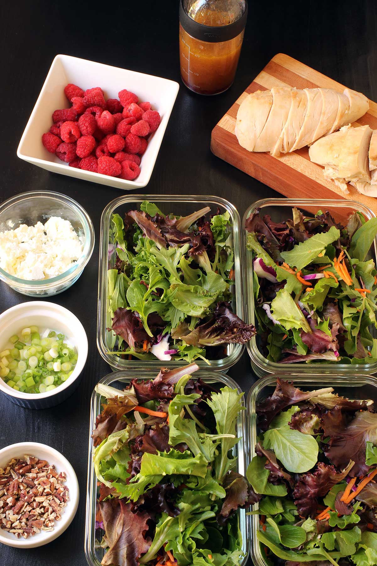 assembling raspberry chicken salads in glass boxes