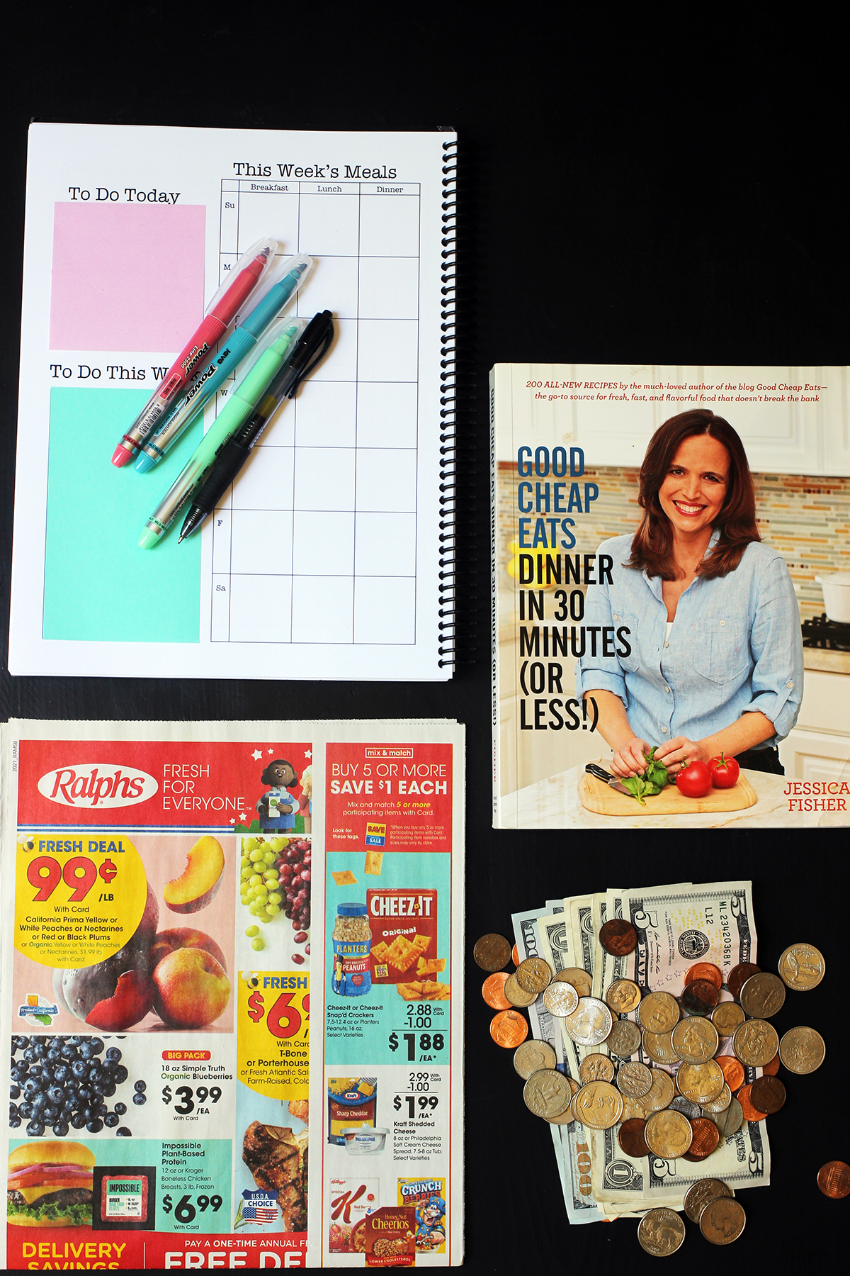 flatlay of planner cookbook grocery ad and money