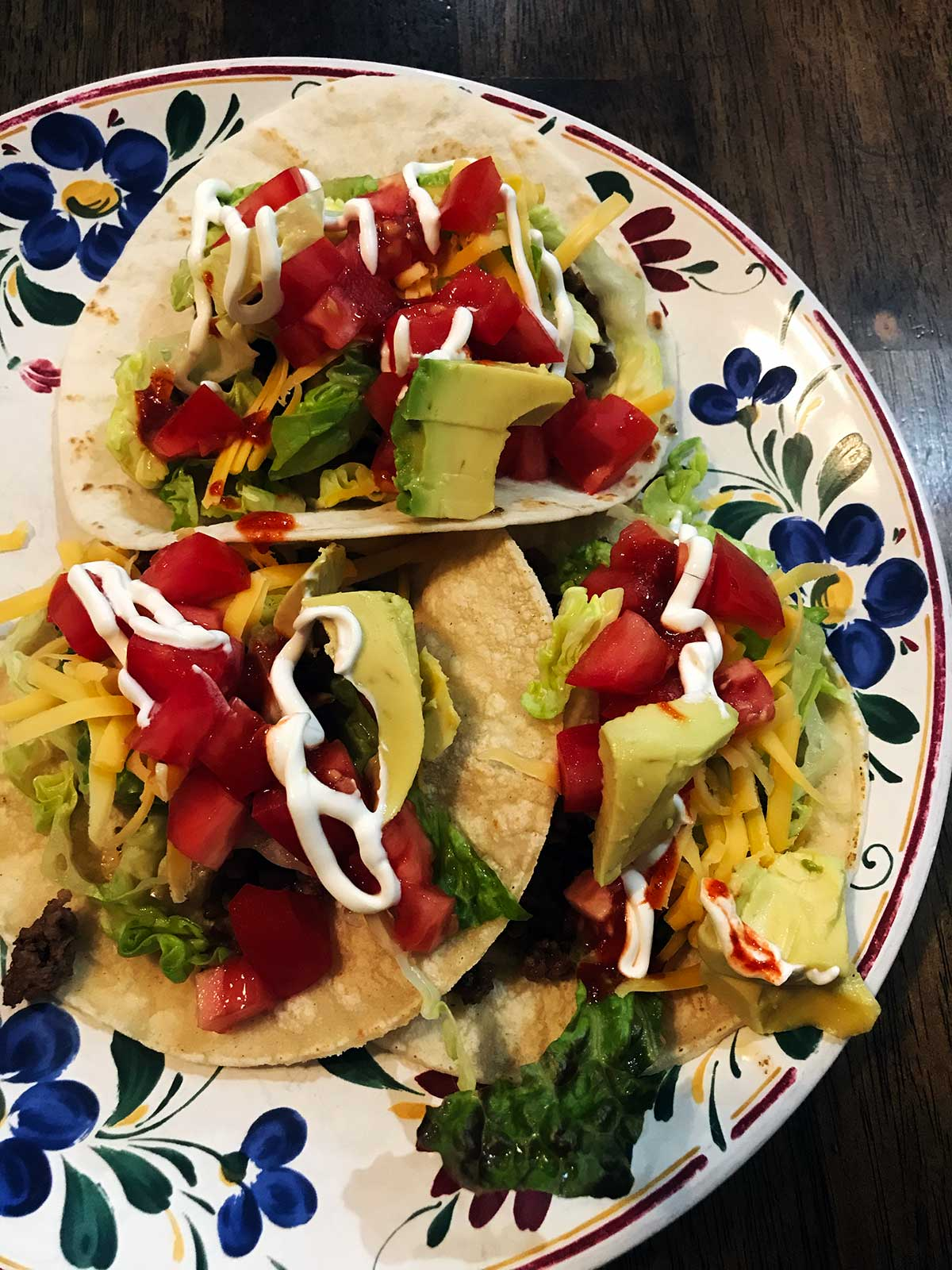 tacos on plate with sour cream