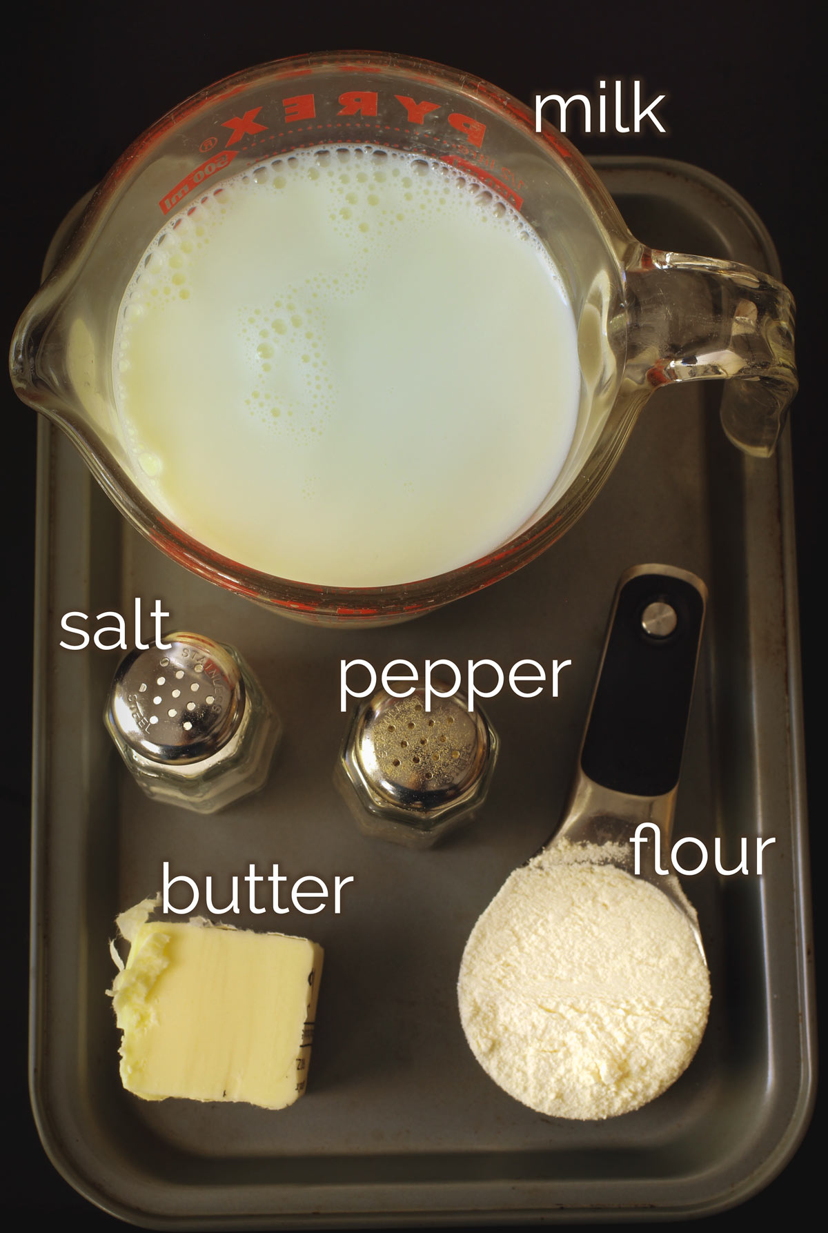 ingredients measured out to make a homemade white sauce.