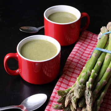 asparagus soup in red mugs