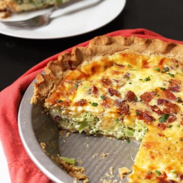 bacon and broccoli quiche with piece removed