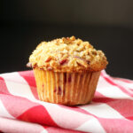 raspberry muffin on red checked cloth