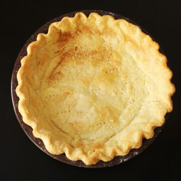 baked pie crust in brown pan