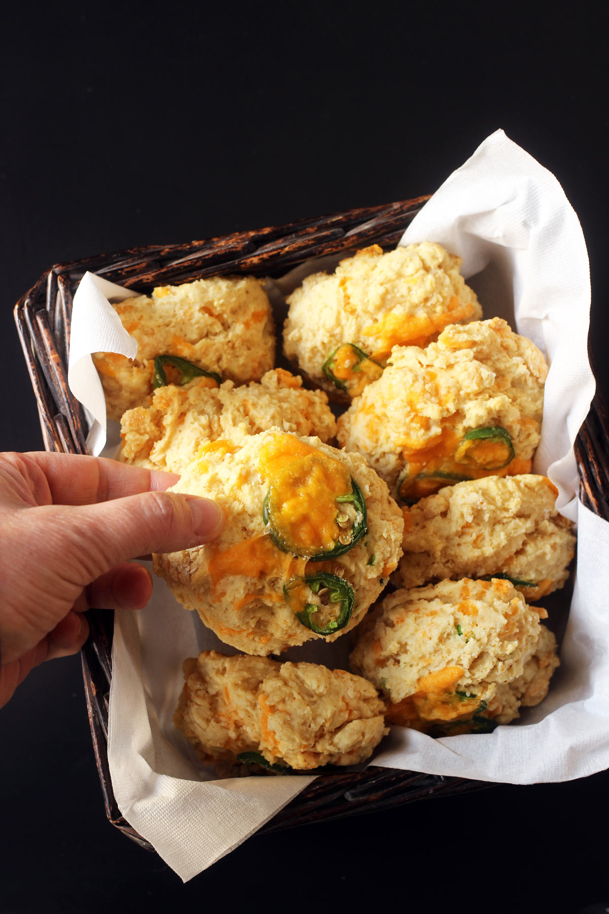 choosing jalapeño biscuit from the basket