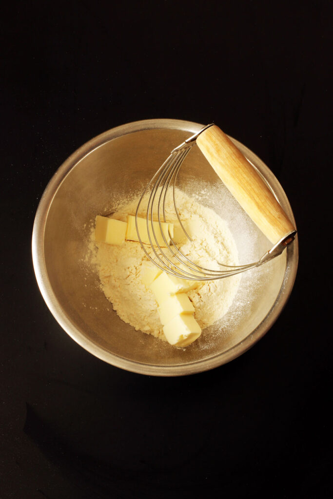 flour and butter in bowl with pastry blender