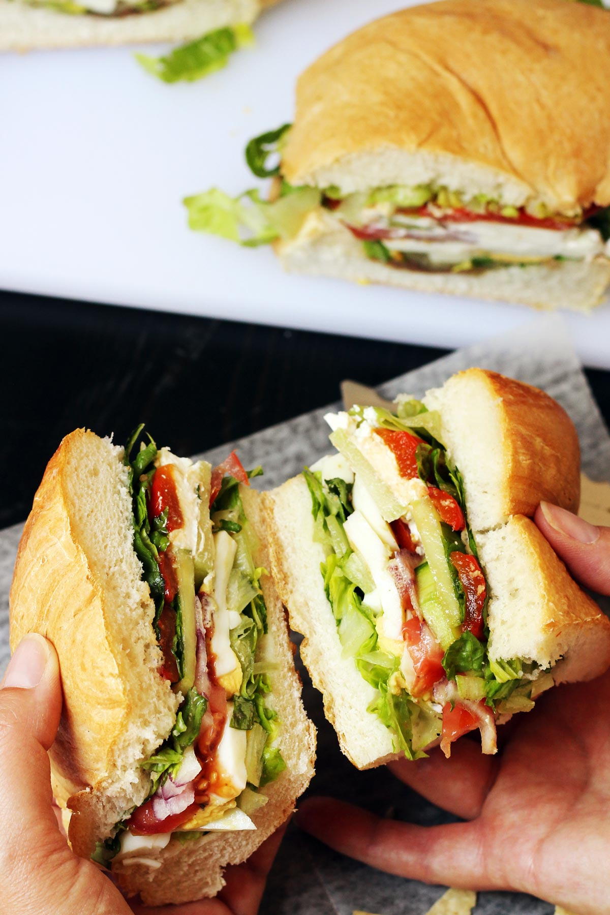 hand holding portions of picnic sandwich