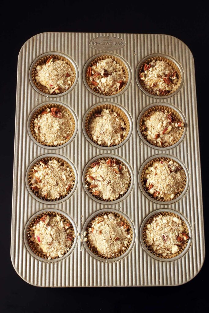 unbaked muffins topped with streusel