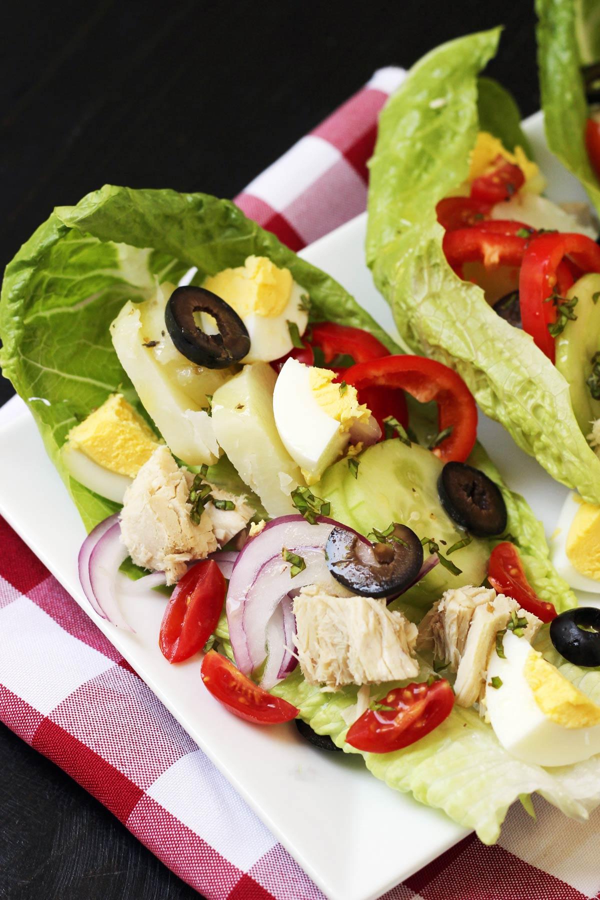 nicoise salad wraps on platter