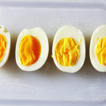sliced hard and soft cooked eggs on board