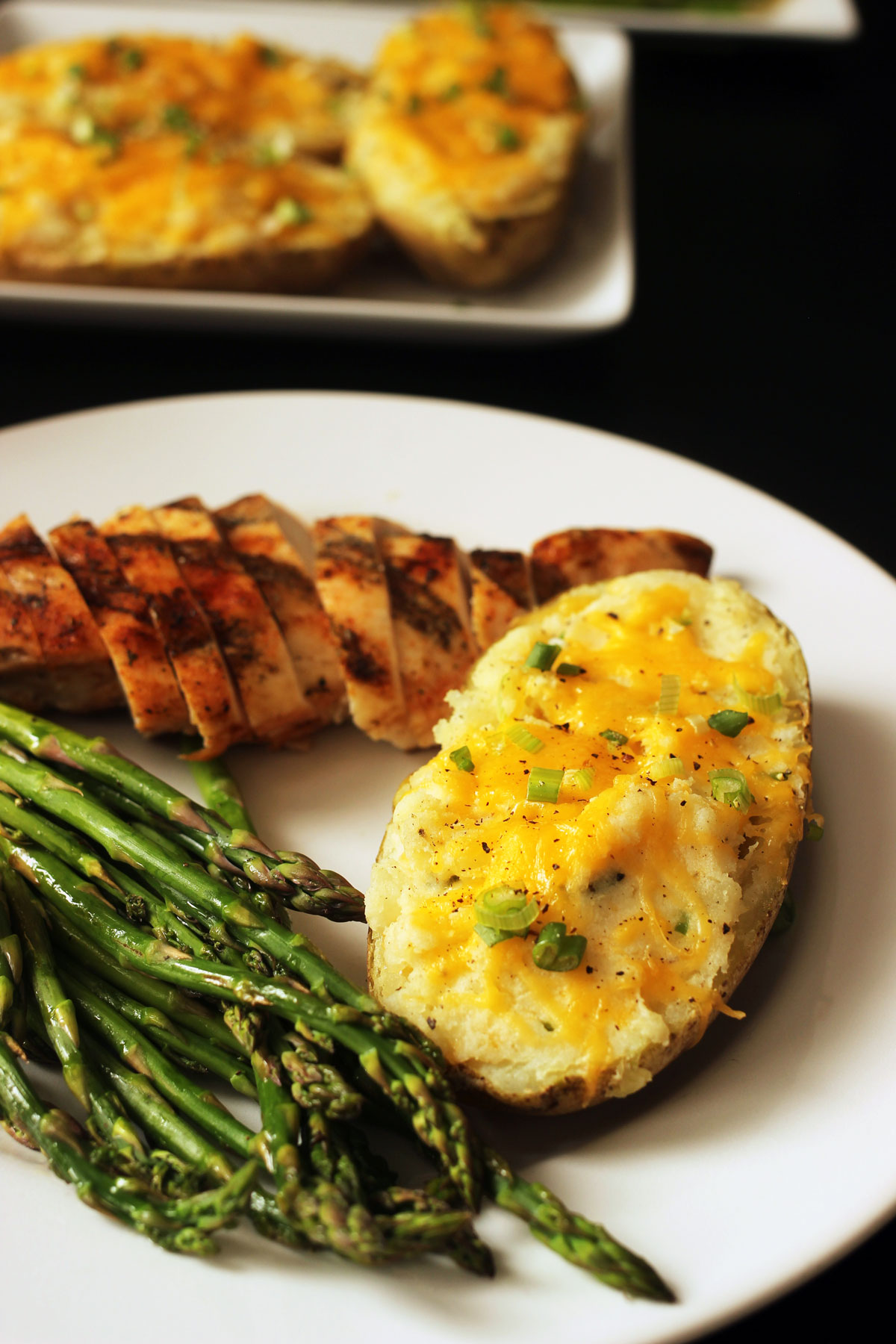 stuffed potato on dinner plate with meal