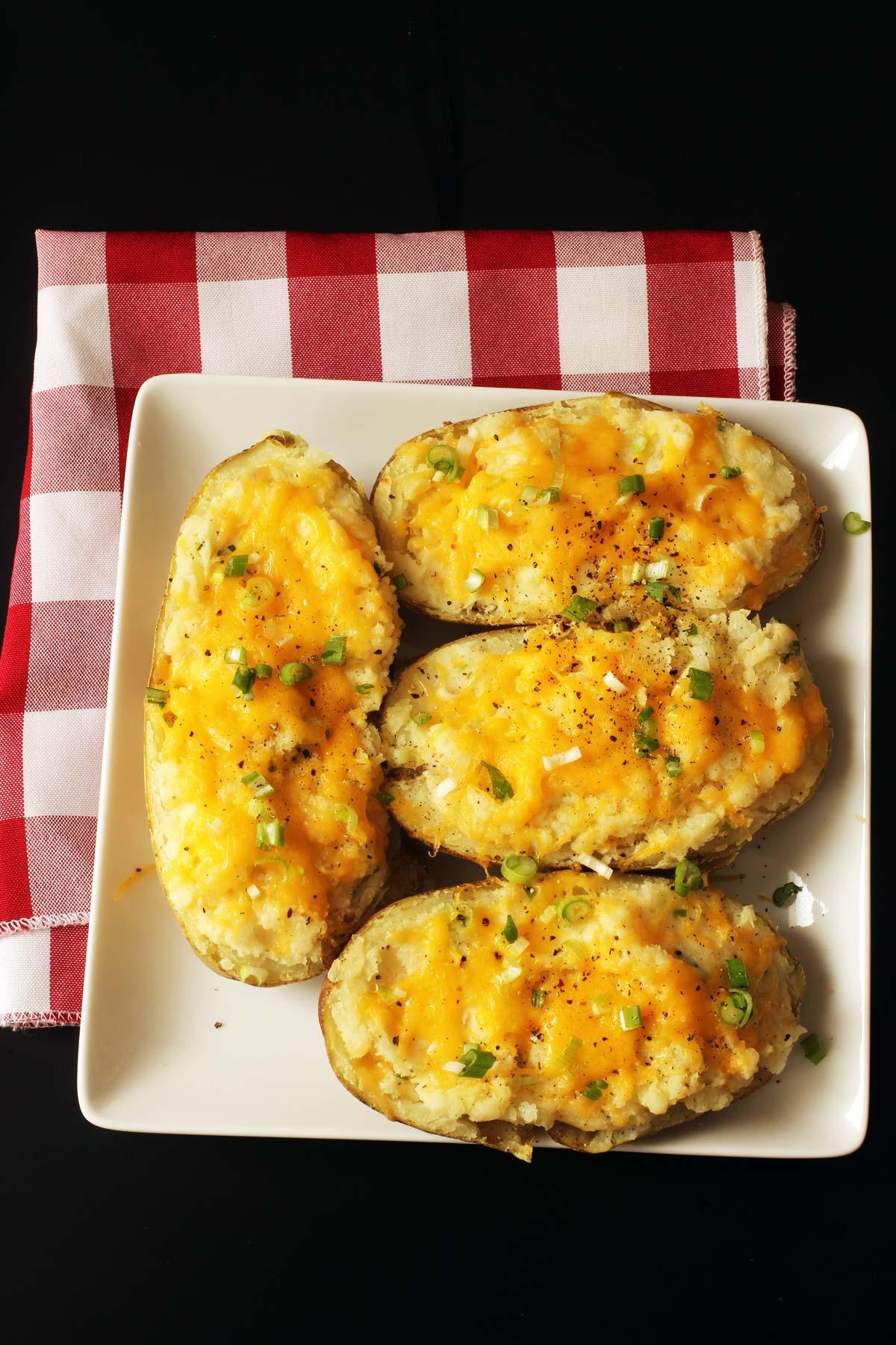 stuffed potatoes on square plate