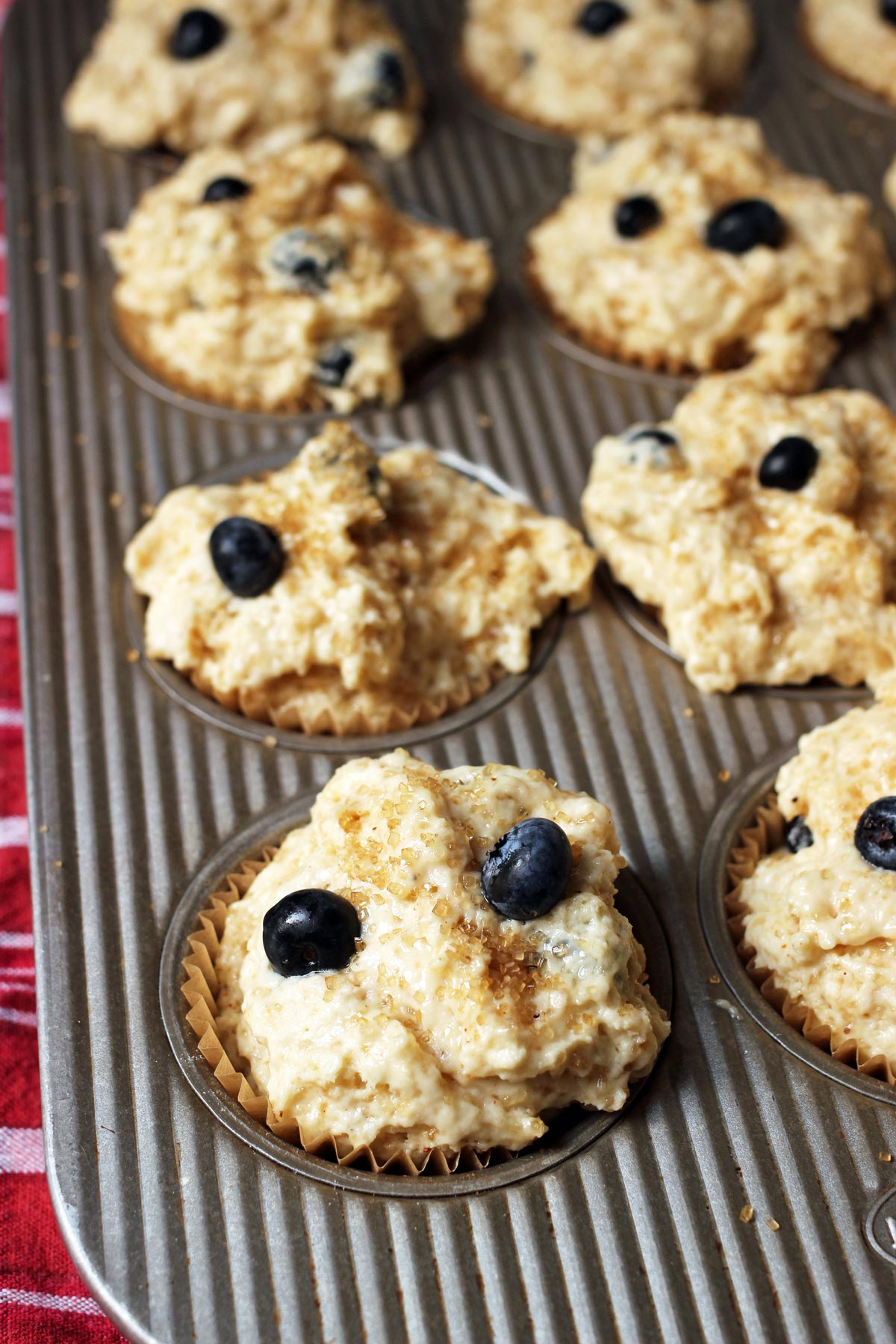 unbaked blueberry muffins in tin