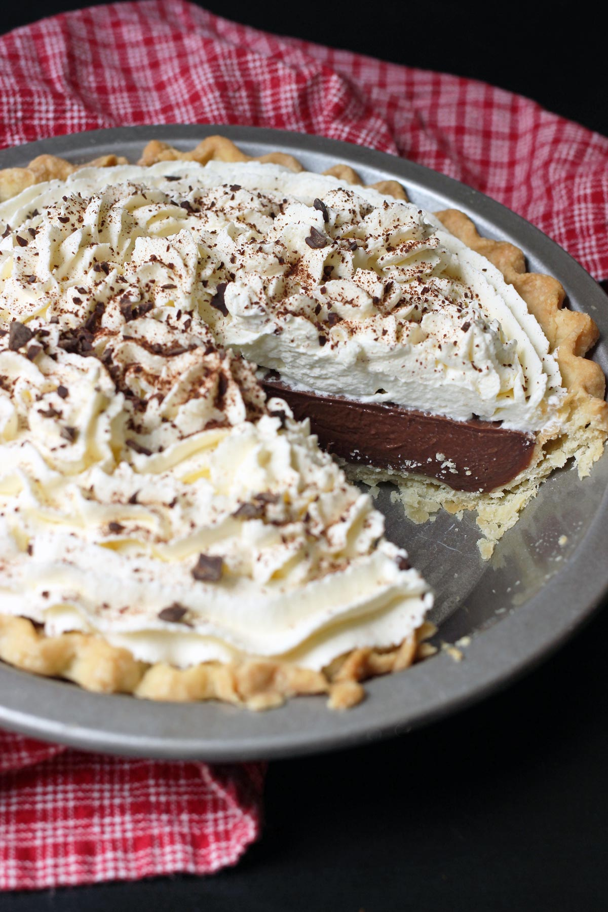 chocolate cream pie with wedge missing