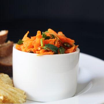 carrot salad in white ramekin