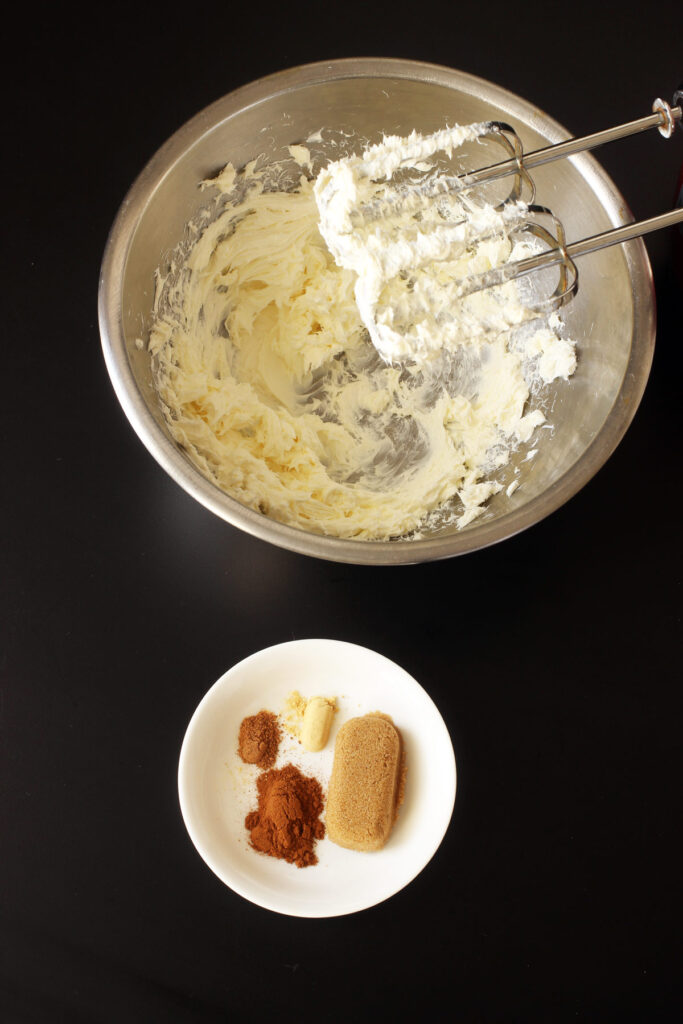 brown sugar and spices next to bowl of cream cheese