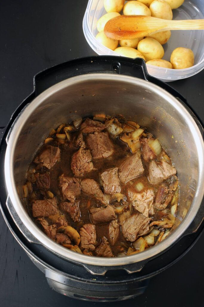 browned meat in pot