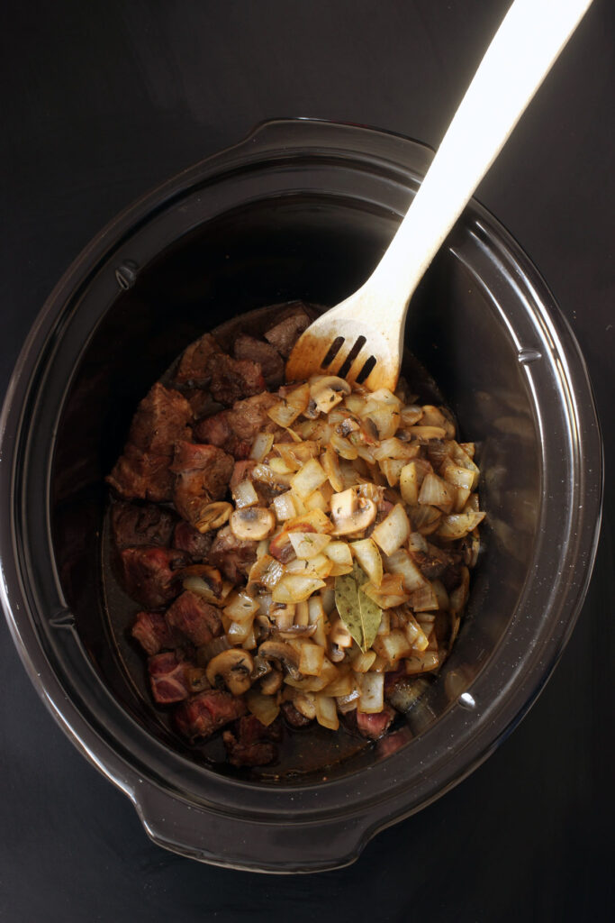 cooked meat in slow cooker