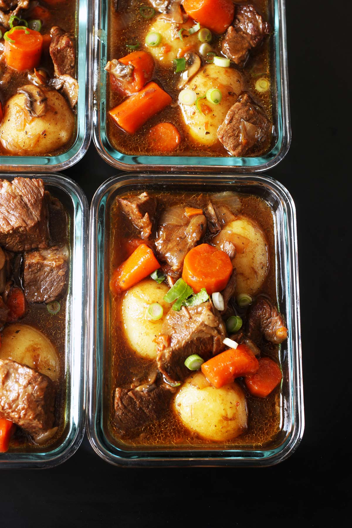 close-up of beef stew in meal prep containers