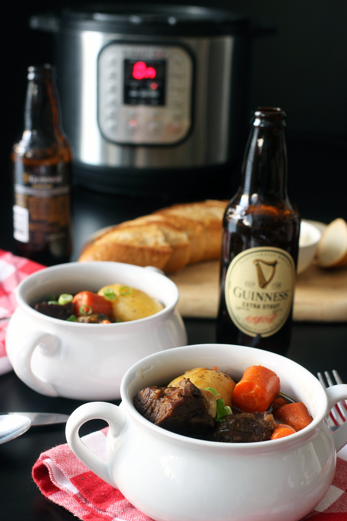 table set with stew, guinness, and instant pot