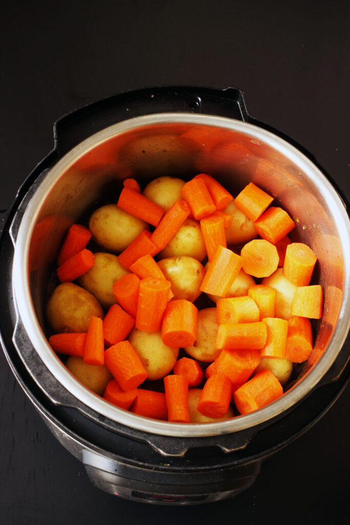 carrots atop potatoes