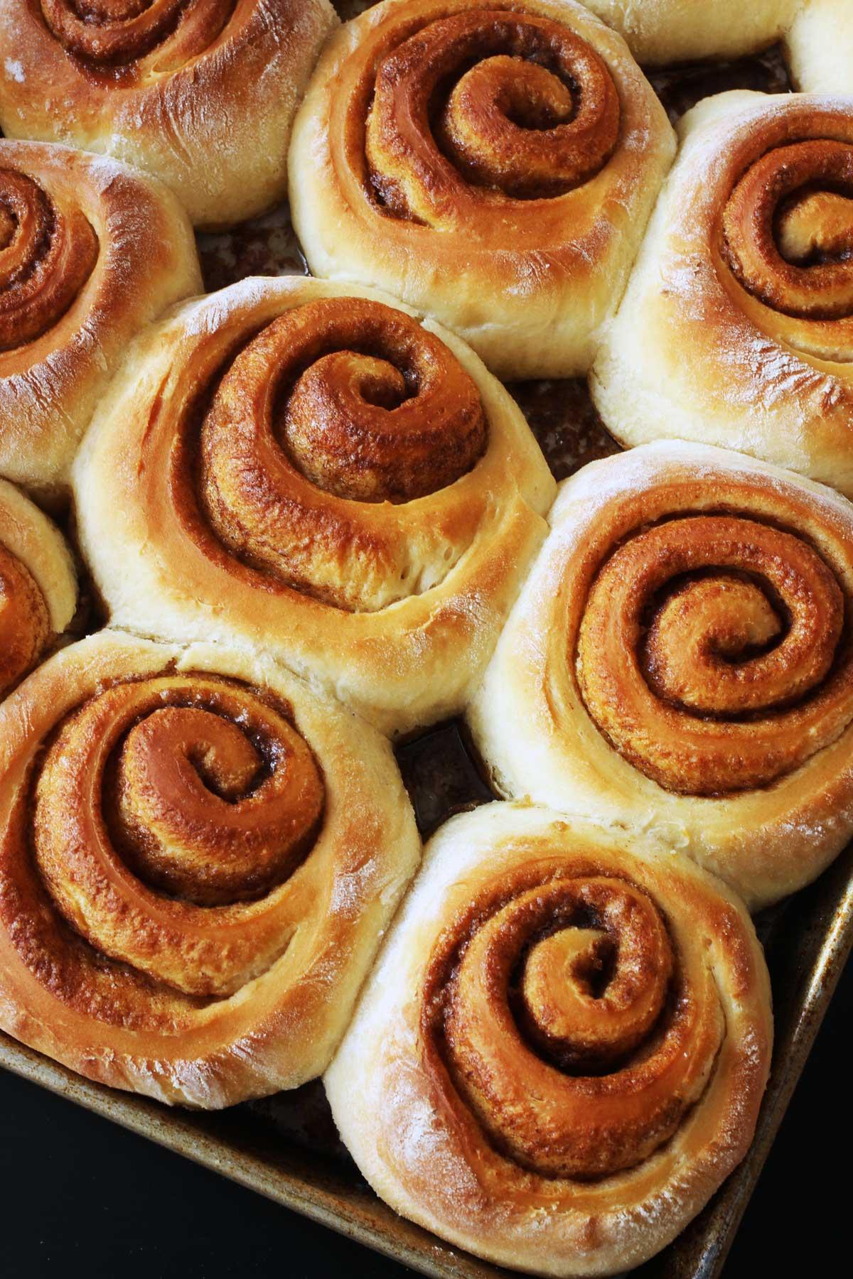 tray of baked orange cinnamon rolls